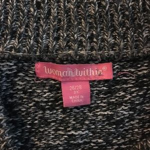 Woman within marked sweater